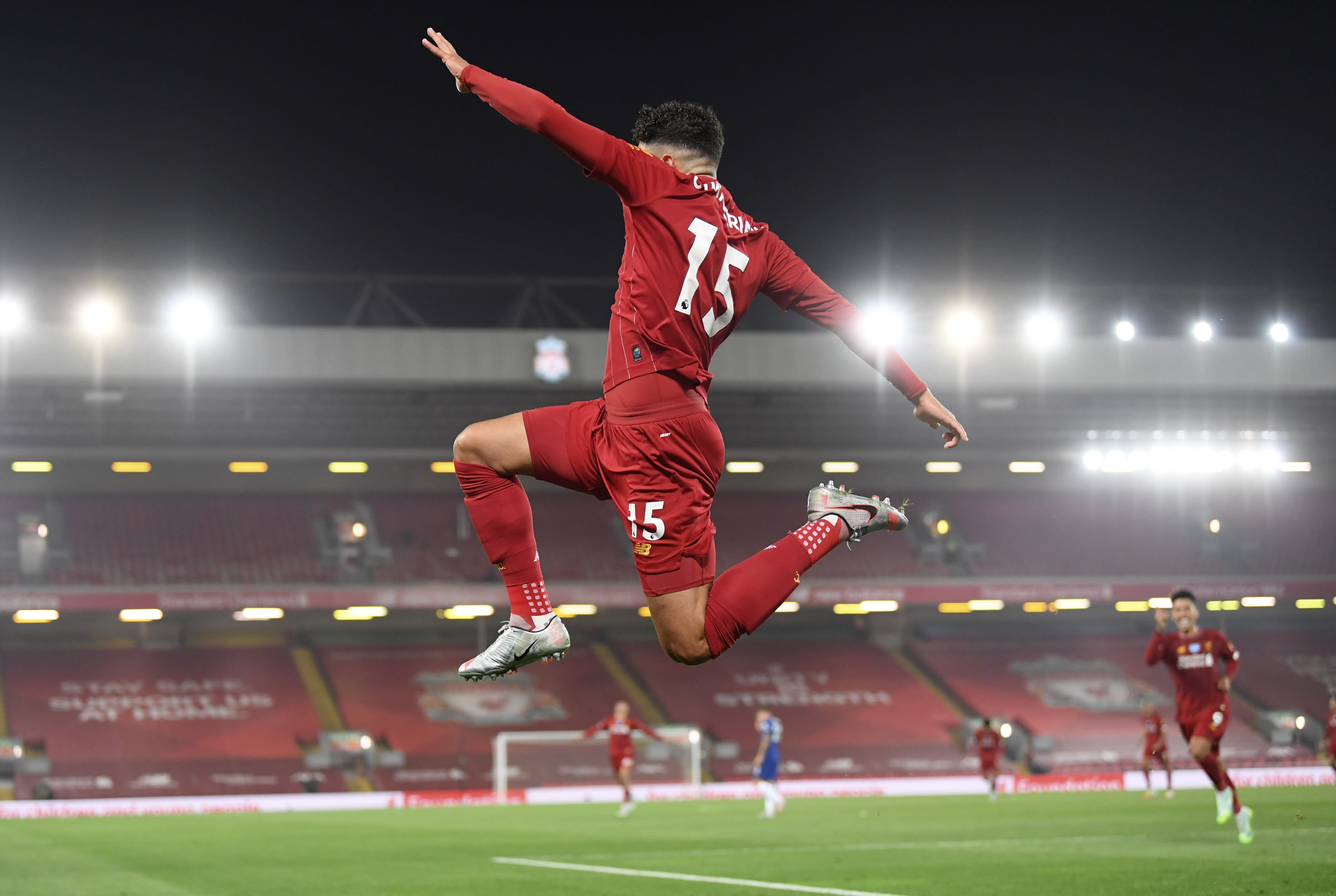 Liverpool's Alex Oxlade-Chamberlain celebrates scoring his side's fifth goal during the English Premier League soccer match between Liverpool and Chelsea at Anfield stadium in Liverpool, England, Wednesday, July 22, 2020. (Laurence Griffiths, Pool via AP)