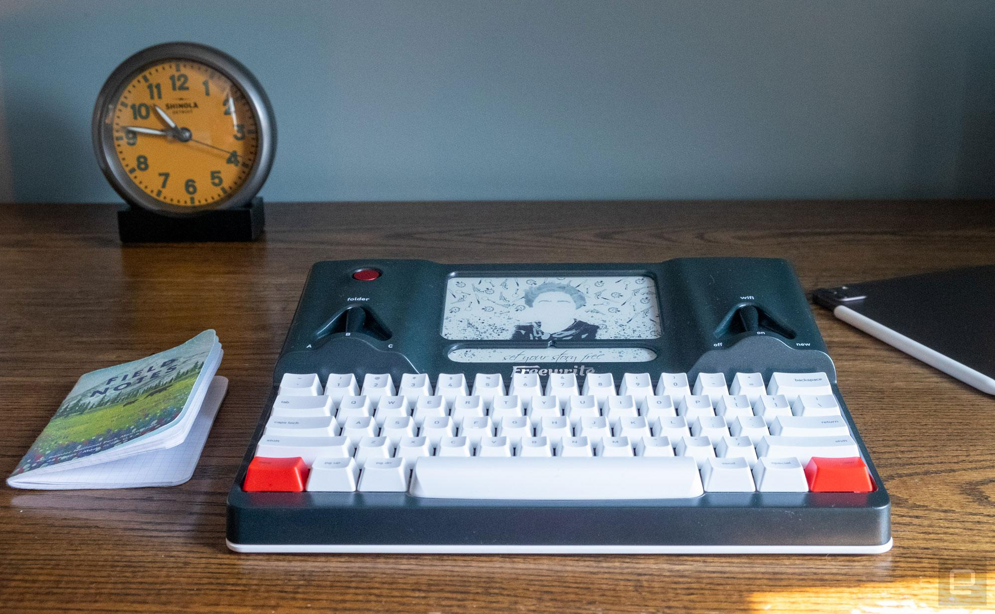 The Freewrite standalone word processor with keyboard sits on an office desktop.