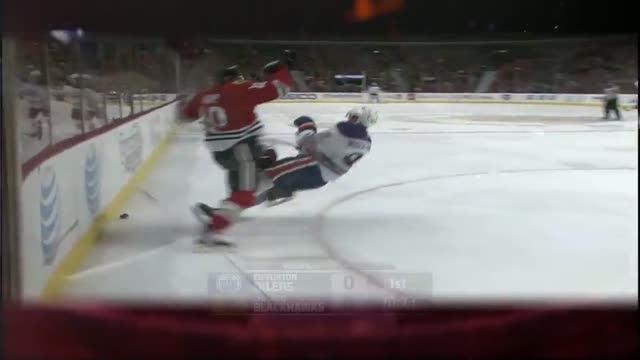 Patrick Sharp lays big hit on Nugent-Hopkins