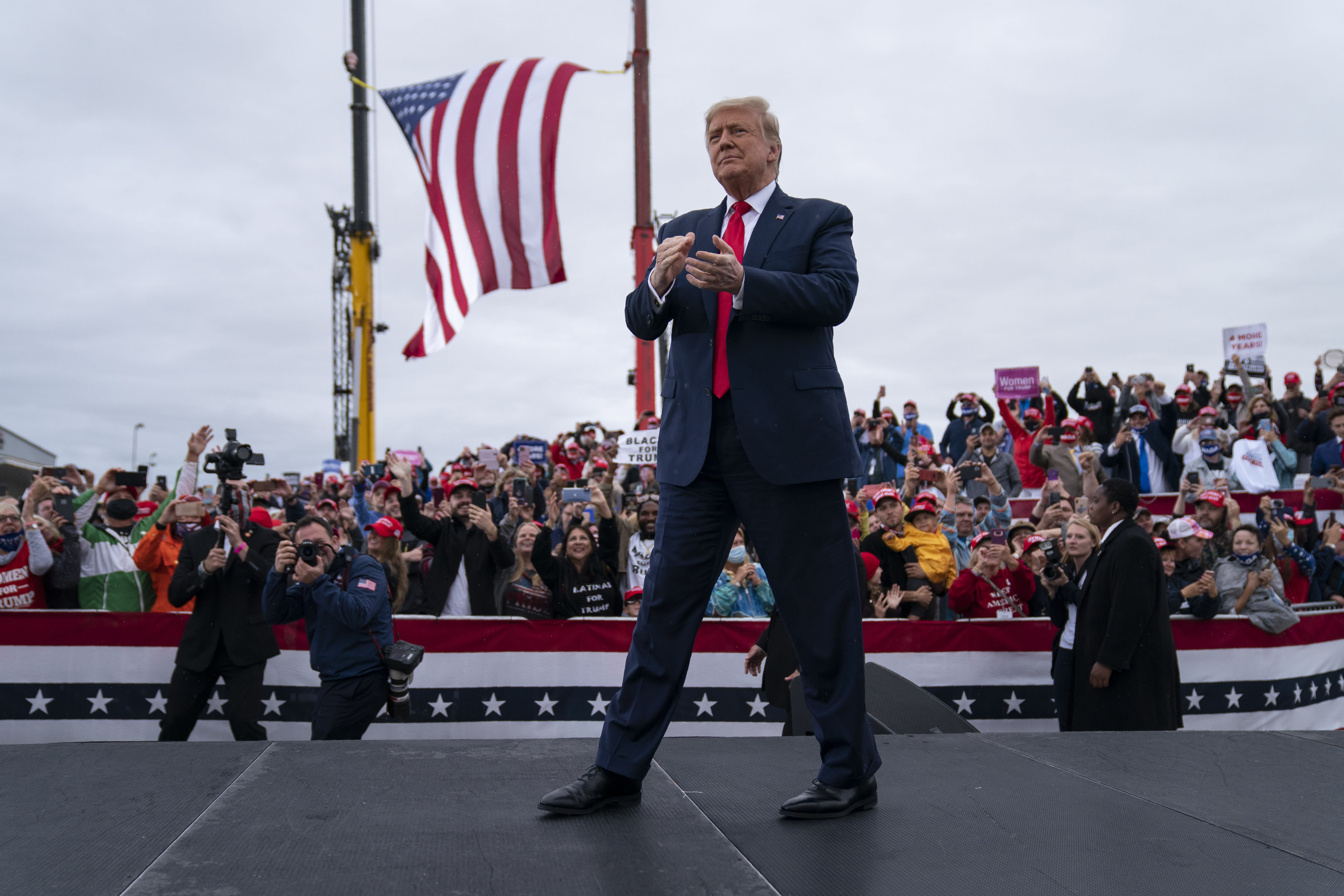 FILE - In this Sept. 10, 2020, file photo President Donald Trump arrives for a campaign rally at MBS International Airport in Freeland, Mich. Campaigns are using different tactics in a pandemic election year unlike any other as candidates try to win over voters in down-ballot races that will determine control of Congress. Trump is setting the tone for his party with big rallies and few masks. (AP Photo/Evan Vucci, File)