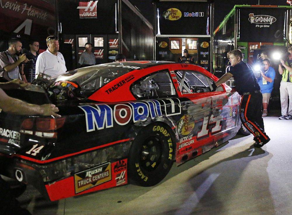 Tony Stewart's car in loaded into the team hauler after hitting the wall in a NASCAR Sprint Cup auto race at Atlanta Motor Speedway Sunday, Aug. 31, 2014, in Hampton, Ga