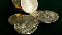 Gold up slightly as dollar drops; Russia buys bullion