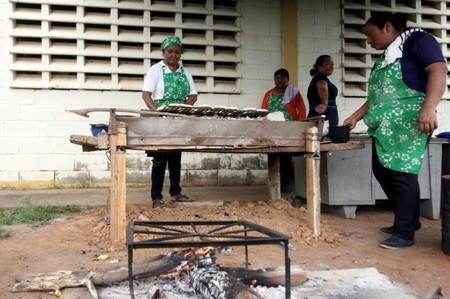 Volunteers help to prepare the meal for students at the San Agustin school in La Canada de Urdaneta