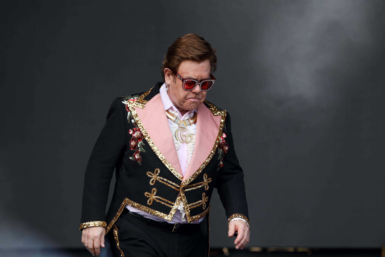 Tearful Elton John cuts concert short due to pneumonia diagnosis