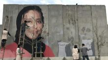 Afghan street artists haunt warlords with graffiti campaign