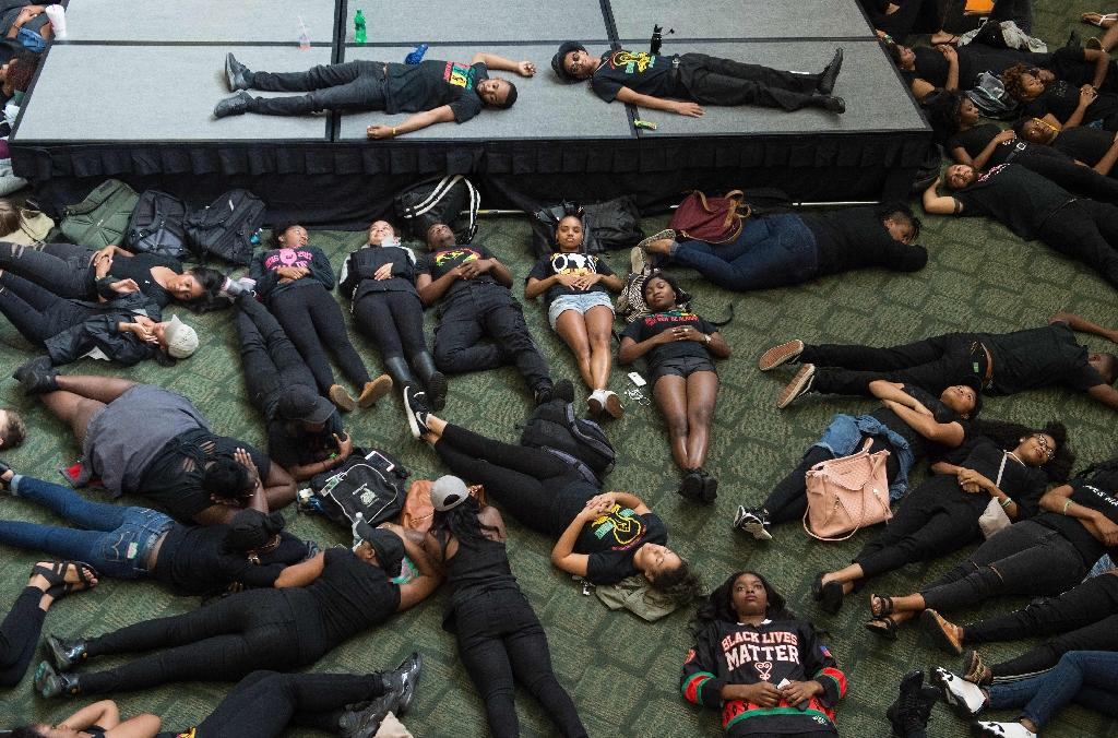 Students take part in a lie-in at the University of North Carolina in Charlotte, North Carolina, on September 21, 2016 in protest against police brutality following the shooting of Keith Lamont Scott nearby the previous day (AFP Photo/Nicholas Kamm)