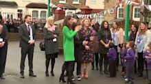 Kate Middleton dazzles in bright green Eponine London dress for visit to primary schools