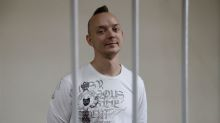 Russia to keep ex-journalist accused of treason behind bars: court