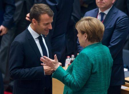 French President Emmanuel Macron and German Chancellor Angela Merkel take part in a European Union summit in Brussels, Belgium June 28, 2018. Stephanie Lecocq/Pool via REUTERS