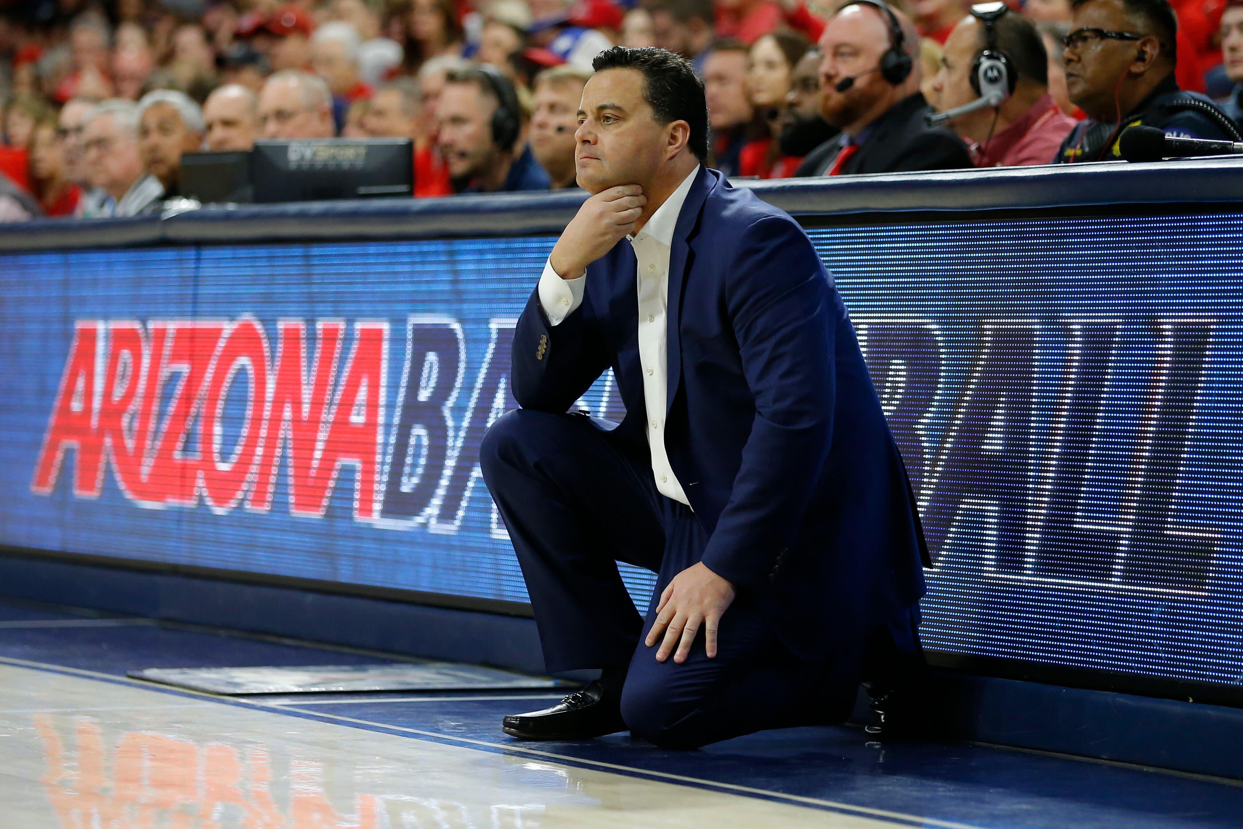 "<a class=""link rapid-noclick-resp"" href=""/ncaaf/teams/arizona/"" data-ylk=""slk:Arizona Wildcats"">Arizona Wildcats</a> head coach Sean Miller looks on during a college basketball game on March 9, 2019. (AP)"
