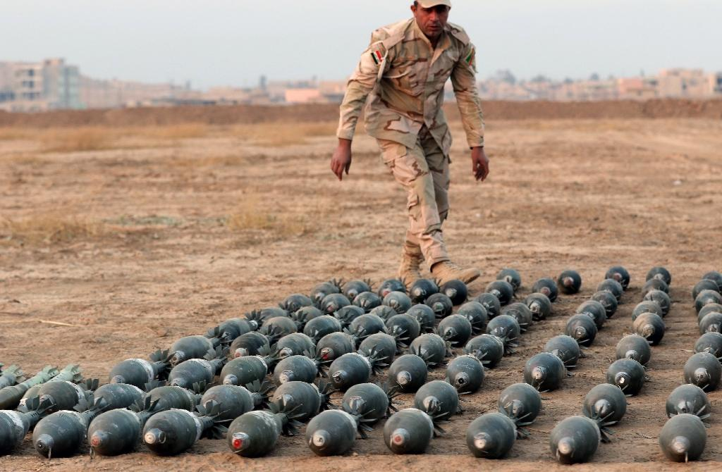 Islamic State group weapons and ammunition are often painted a military green and branded with the group's logo, demonstrating a high standard of production that has astonished arms experts (AFP Photo/Safin Hamed)