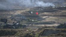Helicopter mistakenly fires on parked vehicles in Russia war games: media