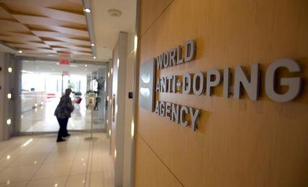 A woman walks into the head offices of WADA in Montreal