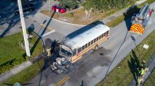 Bus driver is hailed a hero after saving 16 children from a burning school bus
