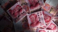 Bond Traders on Yuan-Watch as Trade War Turns Data Into Old News