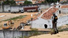 Brazilian authorities build temporary wall to quell deadly prison clashes