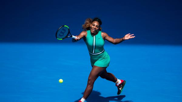 c131a6b76e85 Serena Williams earns raves for wearing green bodysuit and fishnets on the  tennis court