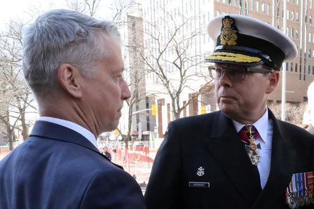 Liberal MP Andrew Leslie greets Vice-Admiral Mark Norman as he arrives at the courthouse in Ottawa, Ontario, Canada, May 8, 2019. REUTERS/Chris Wattie
