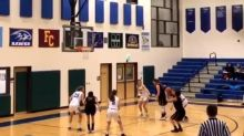 Basketball Player Falls in Free Throw Semicircle Causing Lane Violation