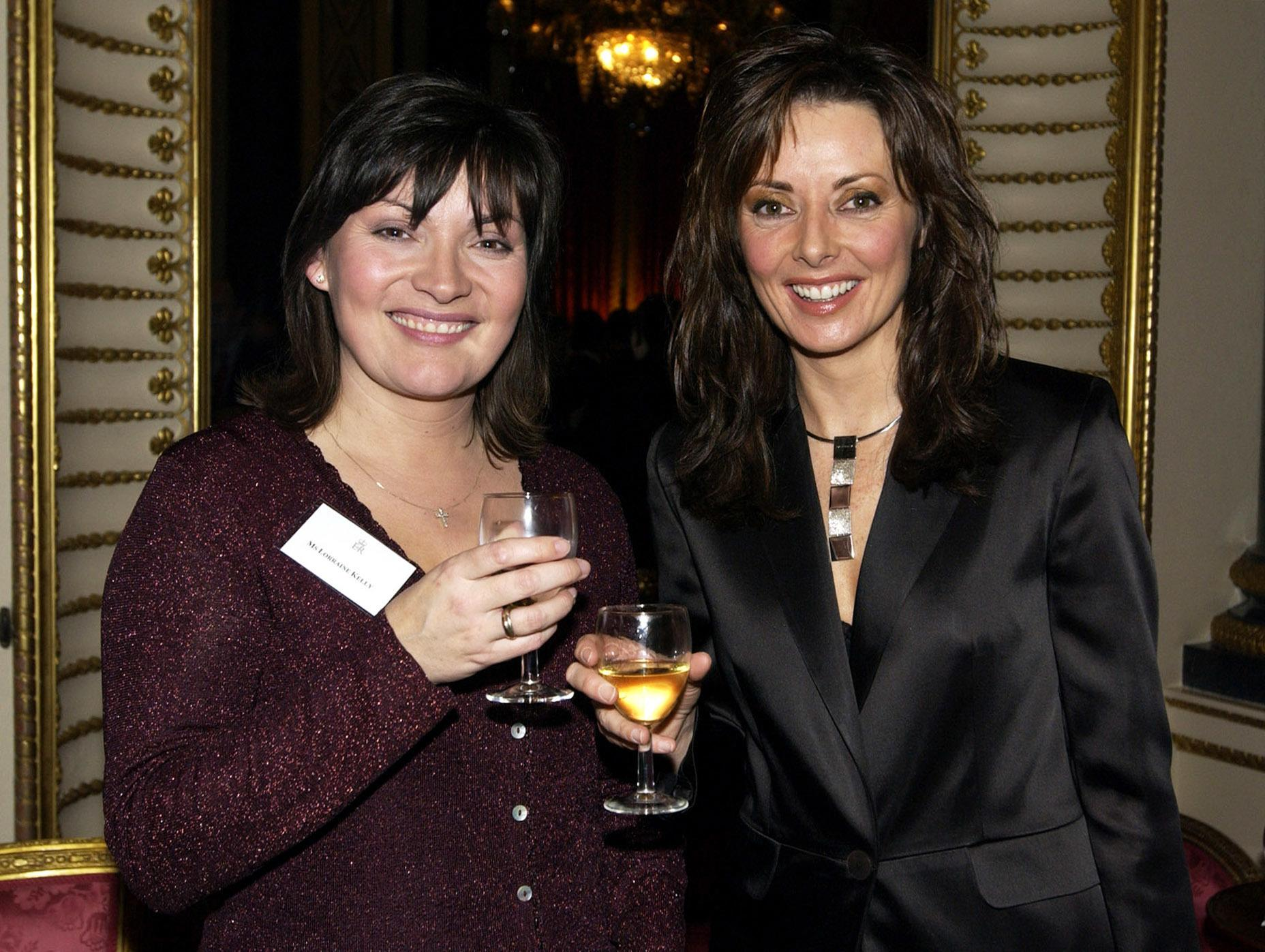 TV presenters Lorraine Kelly (L) and Carol Vorderman at a reception for the British broadcasting industry at Buckingham Palace.