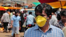 Coronavirus Can Last on Face Masks for a Week, Banknotes for Days: Study
