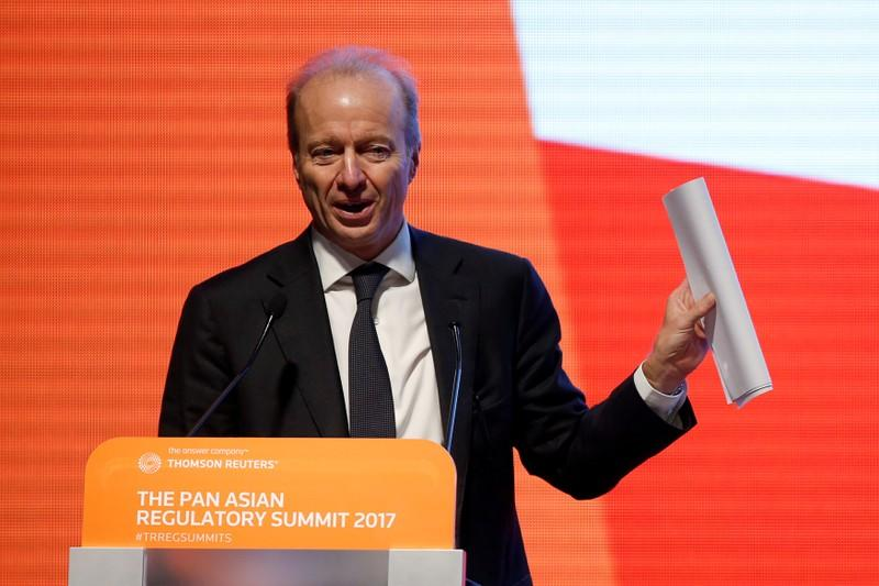 FILE PHOTO: Ashley Alder, Chief Executive Officer of Hong Kong Securities and Futures Commission, addresses a summit in Hong Kong in 2017
