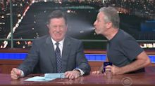 Stephen Colbert And Jon Stewart Swap Some Spit For A Good Cause