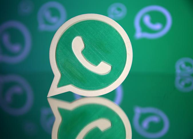 A 3D printed Whatsapp logo is seen in front of a displayed Whatsapp logo in this illustration September 14, 2017. REUTERS/Dado Ruvic