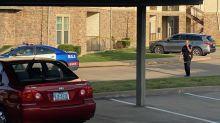Teenage boy held on suspicion of murder in fatal shooting of 2 brothers in Arlington