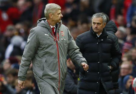 Arsenal manager Arsene Wenger and Manchester United manager Jose Mourinho at the end of the match