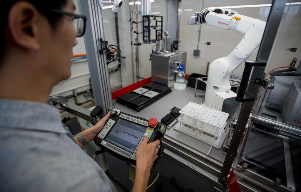 An engineer for Just uses a robotic arm at the company's headquarters office in San Francisco on May 4, 2018; the firm recently started to work on a new kind of meat based on animal cells (AFP Photo/JOSH EDELSON)