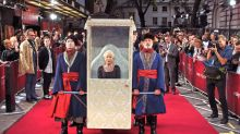 Dame Helen Mirren arrives at film premiere in ornate litter carried by four men