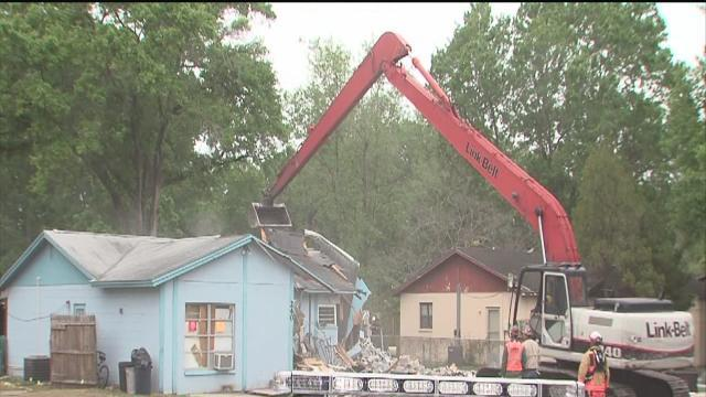 Demolition of sinkhole home continues
