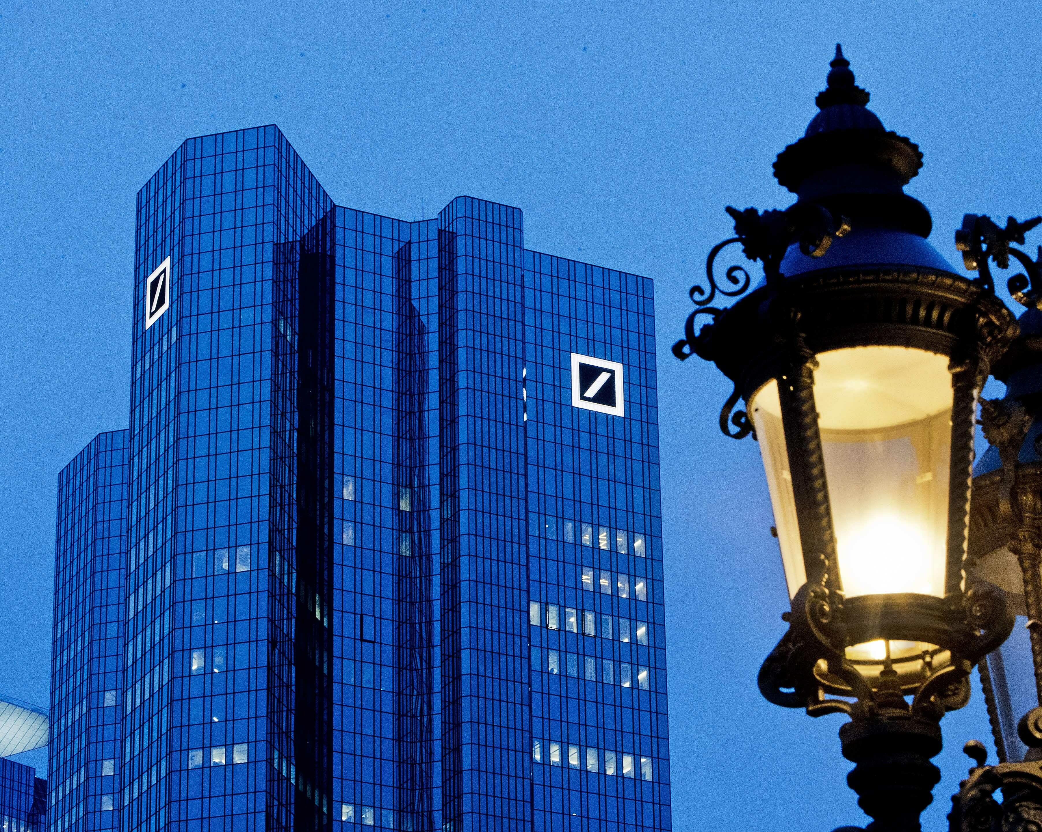 Deutsche Bank struggles to rebound, merger rumors hit shares