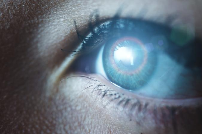Human eye technological concept.