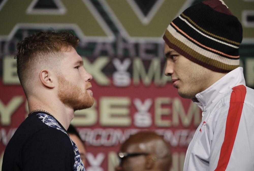 Canelo Alvarez (left) and Julio Cesar Chavez Jr. are fighting at a 164.5-pound limit. (AP)