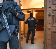Teen girl stands trial for 'IS' police stabbing in Germany