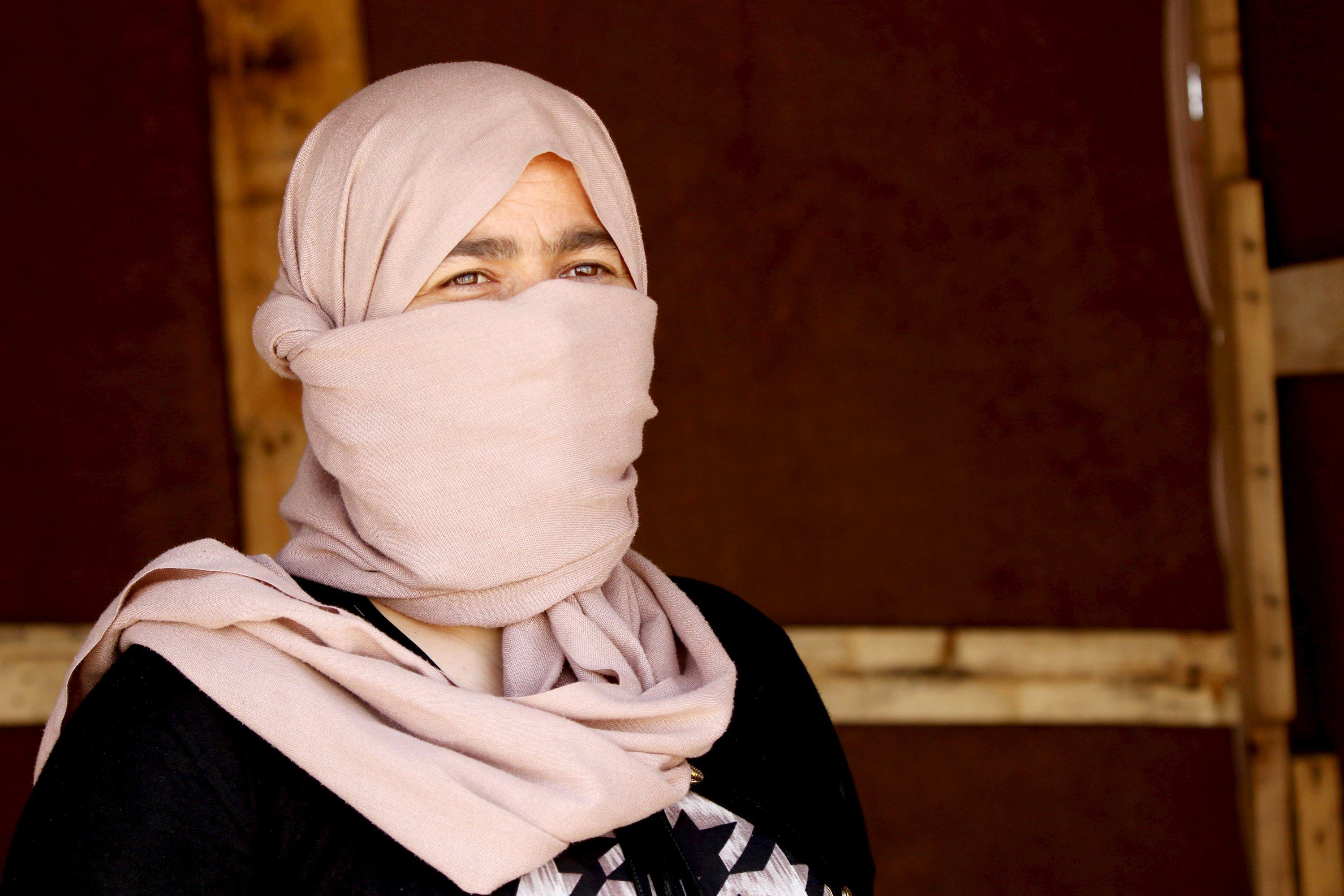 A 27-year-old Yazidi woman, who escaped from captivity by Islamic State (IS) militants, is pictured at Sharya refugee camp on the outskirts of Duhok province July 4, 2015. The woman and her sister were among one hundred women, men and children taken by IS as prisoners after the militants attacked their village of Tal Ezayr in the northern Iraqi province of Mosul close to Syrian border last year. In an interview with Reuters TV, the sisters talked about their horrific ordeal, treatment of women by the militants, and their eventual escape. Picture taken July 4, 2015. REUTERS/Ari Jala