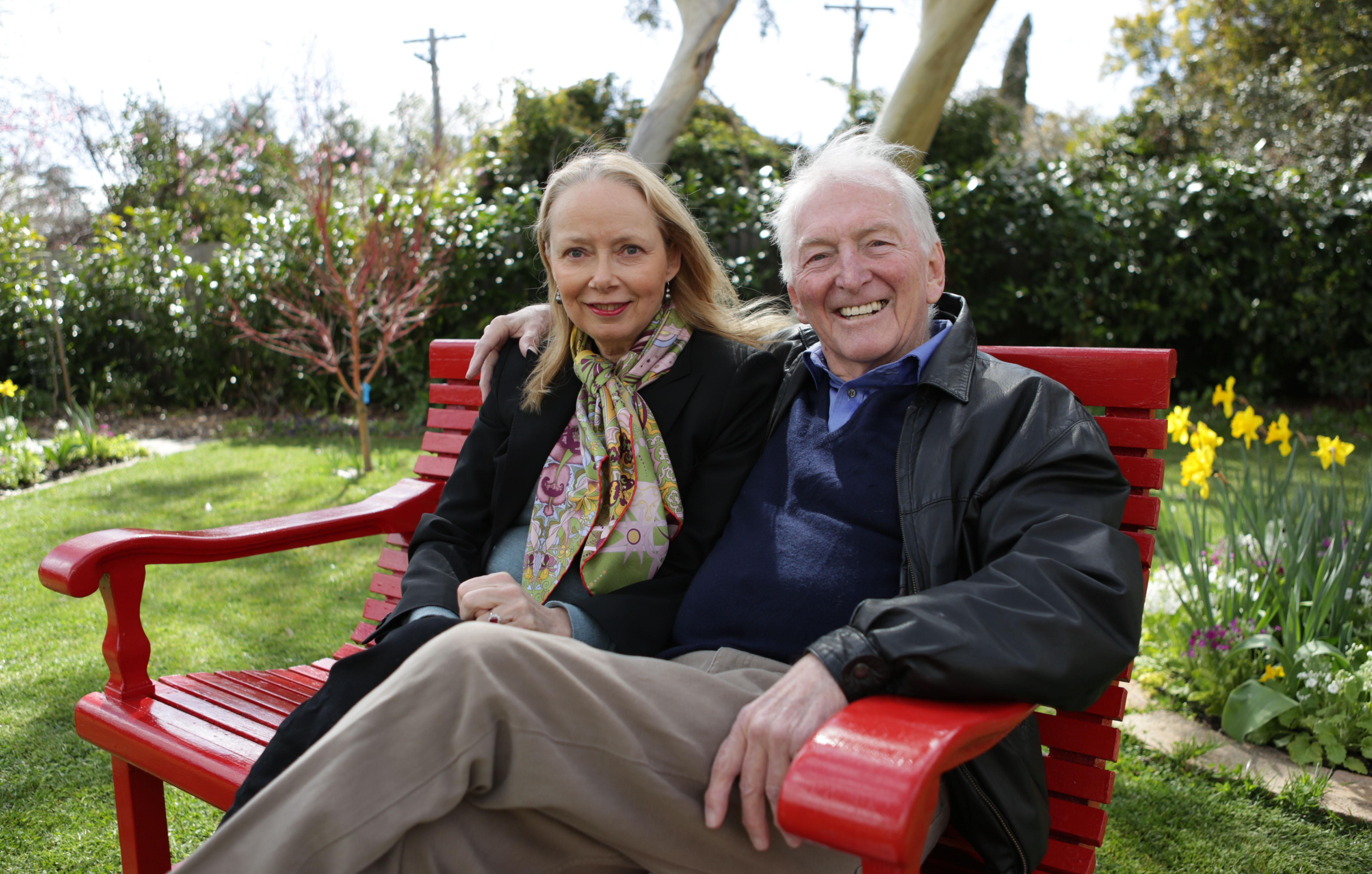 "In this Aug. 30, 2012 photo provided by Penguin Books, Australian best-selling author Bryce Courtenay poses with wife Christine Gee on a park bench in Canberra Australia Courtenay, author of ""The Power Of One"" and 20 other titles died Thursday Nov. 22, 2012 of stomach cancer. He was 79. (AP Photo/Penguin Books) EDITORIAL USE ONLY, NO SALES"