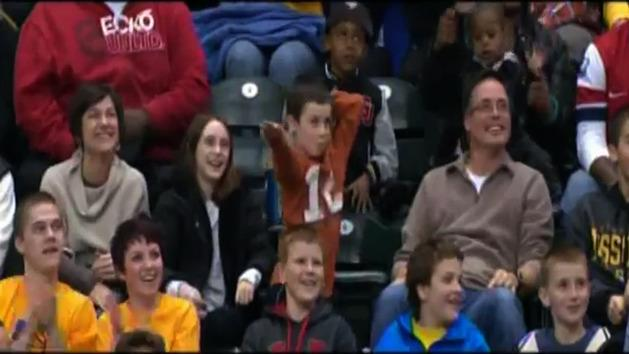 Kid dances at NBA game, embarrasses mum