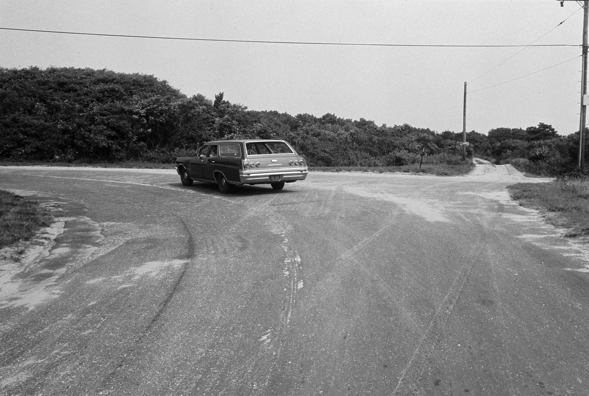 A car follows the curve of Chappaquiddick Road to the left on Chappaquiddick Island near Edgartown, Mass., on Aug. 9, 1969. Cemetery Road is straight ahead. On the night of his car accident with Mary Jo Kopechne, Ted Kennedy turned right onto Dike Road and drove off the bridge farther down. (Photo: Bettmann/Getty Images)