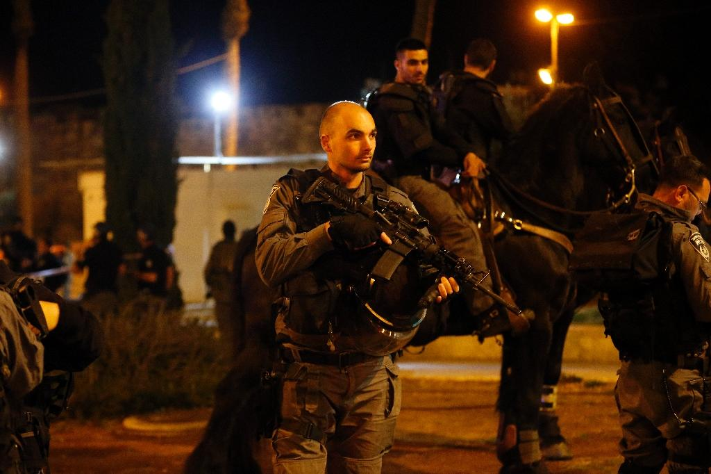 Israeli police stand guard where a Palestinian man was shot dead by security forces after he opened fire near the Damascus Gate, a main entrance to Jerusalem's Old City on February 14, 2016 (AFP Photo/Ahmad Gharabli)