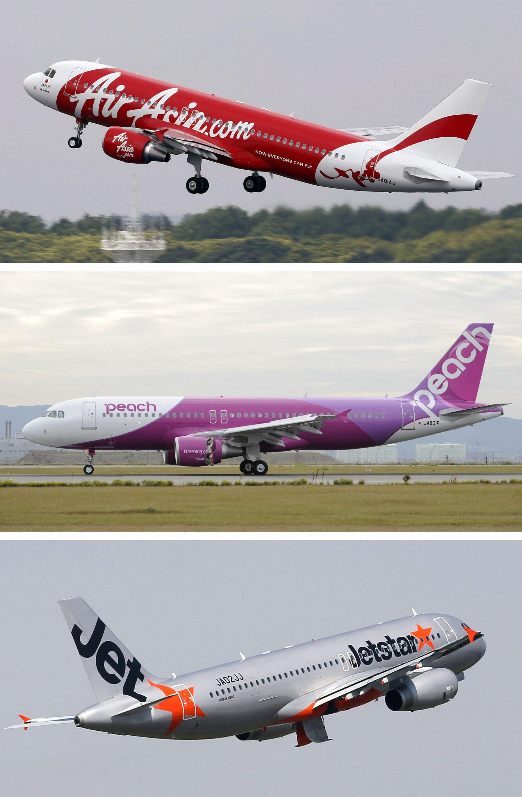 In this combination of three undated photos, planes of Japan's low-cost airlines, from top, AirAsia Japan, Peach Aviation and Jetstar, are shown in Japan. Japan has a reputation for loving expensive things like overpriced real estate, gourmet melons and luxury brands. But the nation is finally discovering the joy of flying cheap, with the arrival this year of three low-cost carriers. The takeoff of AirAsia Japan, Peach Aviation and Jetstar Japan could change lifestyles. (AP Photo/Kyodo News) JAPAN OUT, MANDATORY CREDIT, NO LICENSING IN CHINA, FRANCE, HONG KONG, JAPAN AND SOUTH KOREA