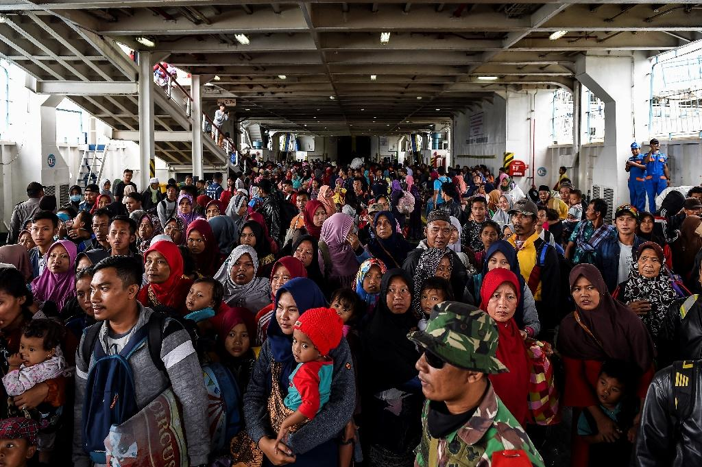 Residents of tiny islands in the Sunda Strait were evacuated to shelters as fresh activity at the Anak Krakatoa volcano threatened to spark another tsunami (AFP Photo/MOHD RASFAN)