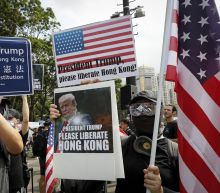 The Latest: Hong Kong protesters target Chinese emblem