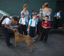 Teachers who don't flee Venezuela get side gigs to survive