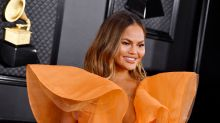 Chrissy Teigen goes low-key for baby gender reveal: 'No fires and no one shot'