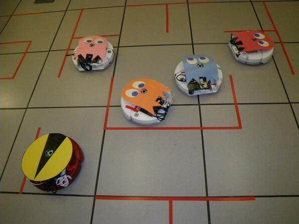 Autonomous Roombas do Pac-Man right (video)