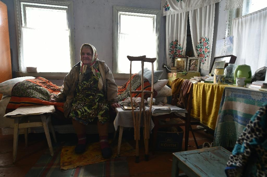 """Maria Urupa, who is in her early 80s, is a """"samosely"""", or self-returner, as inhabitants of the Chernobyl exclusion zone are known (AFP Photo/Sergei Supinsky)"""