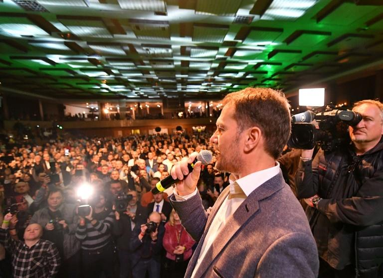 OLaNO party leader Igor Matovic speaks to supporters on his way to a resounding election victory (AFP Photo/JOE KLAMAR)